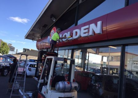 David Schroeder cleaning the Holden sign
